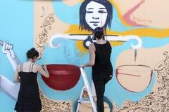 Graffiti dei pittori nel corso della via Art Festival Thess Fotografia Stock