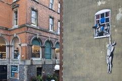Graffiti del Banksy a Bristol Fotografia Stock