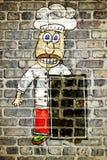 Graffiti del cuoco sul muro di mattoni del ristorante Fotografie Stock Libere da Diritti