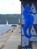 Graffiti dell'ippocampo sul frangiflutti Fotografia Stock Libera da Diritti