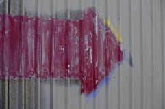 Graffiti della freccia di lerciume Immagini Stock