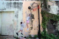 Graffiti della parete di Penang Fotografie Stock