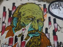 Graffiti showing an old man. Graffiti depicting the face of an old man with a green face surrounded by knifes Royalty Free Stock Photography
