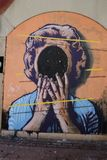 Graffiti depicting the face of a woman.. Graffiti on a wall with the image of a womanholding a mirror Royalty Free Stock Image