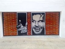 Graffiti depicting Jack Nicholson in the movie The Shining Royalty Free Stock Image