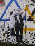 Graffiti depicting two young people. Graffiti depicting two young people looking up to something above their heads Royalty Free Stock Photo