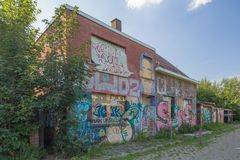 Graffiti and deserted houses Stock Photos