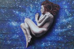 Graffiti design with a naked woman dreaming in the sky full of stars Royalty Free Stock Photo