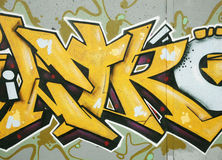 Graffiti detail. Inner city background with colorful graffiti stock images