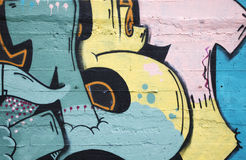 Graffiti detail. Inner city background with colorful graffiti royalty free stock photo