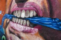 Graffiti detail aggressive face valparaiso Royalty Free Stock Photo