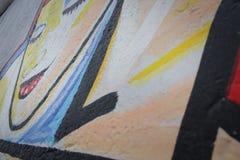 Graffiti detail of berlin wall, east side gallery. Murales royalty free stock photos