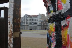 Graffiti detail of berlin wall, east side gallery. Murales stock image