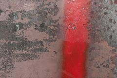 Graffiti detail on old building facade. Red painted line on a wall. Backgrounds and wallpapers. Abstract background stock photos