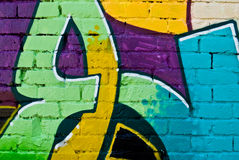 Graffiti detail on a textured brick wall royalty free stock images