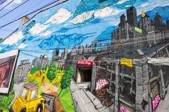 Graffiti di consegna della via Immagine Stock