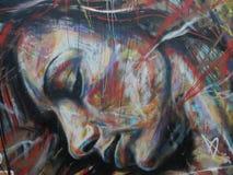 Graffiti die een vrouwelijk gezicht afschilderen Royalty-vrije Stock Foto