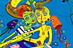 Graffiti die op de breackwatermuur bij Haven o wordt geschilderd Stock Afbeelding