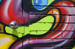 Graffiti Door. A door is covered in various graffiti colors and designs Stock Photos