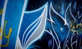 Graffiti drawing on the wall. Blue graffiti drawing on the wall Royalty Free Stock Photo
