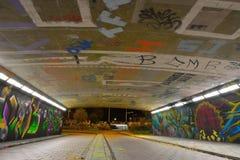 Graffiti dzielą dzwonią klatka Obrazy Royalty Free