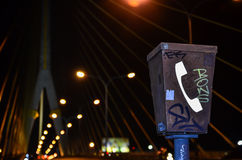 Graffiti on emergency telephone. On a high way raod at night Stock Image