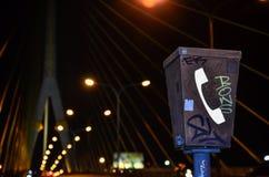 Graffiti on emergency telephone. On a high way raod at night stock image