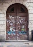 Graffiti on entrance gate of a building, Barcelona Stock Photo