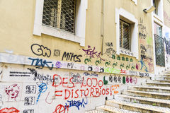Graffiti on a facade in the old town of Lisbon Stock Photography