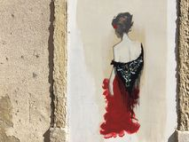 Graffiti of a fado woman in the streets of lisbon royalty free stock photography