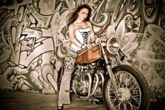 Graffiti Fun. Fun girl on motorcycle stock photos