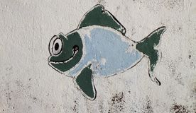 Graffiti of funny fish of on the wall Royalty Free Stock Photo