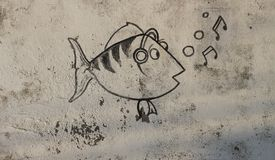 Graffiti of funny singing fish of on the wall Royalty Free Stock Photography