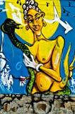 Graffiti gemalt auf der breackwater Wand an Kanal O Lizenzfreie Stockbilder