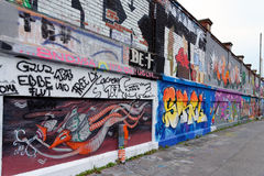 Graffiti, Germany. MUNICH, GERMANY - 4 AUGUST 2015: Vibrant urban art at the famous legal graffiti spot - Tumblingerstrasse in Munich, Bavaria Royalty Free Stock Photo