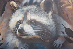 graffiti Geschilderde wasbeer op de muur vector illustratie