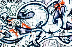 Graffiti: Geweven Bakstenen muur Stock Foto