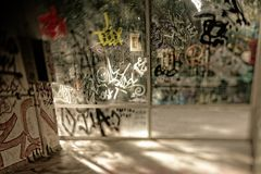 Graffiti on glass, of unknown artists royalty free stock photography