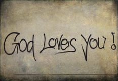 Graffiti: God loves you! on a wall Stock Images