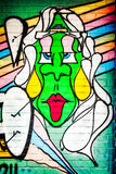 Graffiti Green face. Graffiti is writing or drawings that have been scribbled, scratched, or sprayed illicitly on a wall or other surface, often in a public Stock Photography