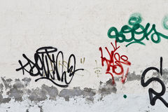Graffiti on grunge wall stock photography