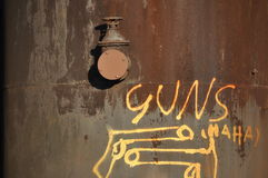 Graffiti: GUNS  Haha Stock Photo