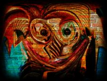 Graffiti Happy Monster on Brick Wall Royalty Free Stock Images
