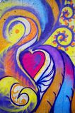 Graffiti heart. Colorful grafitti on structured wall Stock Photos