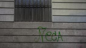 Graffiti on house facade in milan stock images