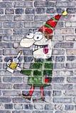 Graffiti ivre d'homme sur la façade de Pub Photographie stock libre de droits