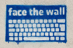 Graffiti keyboard. Graffiti face the wall made with stencil on a wall Royalty Free Stock Image