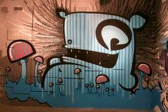 Graffiti - kiwie met paddestoelen Stock Foto