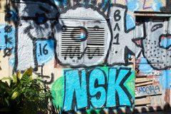 Graffiti on a wall of a small street in Plaka, Athens royalty free stock photo
