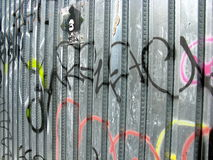 Graffiti on metal fence. Abstract graffiti on a metal fence Stock Photography